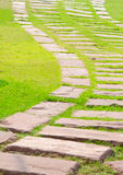 Stone walkway on green grass Royalty Free Stock Photos