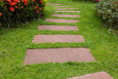 Stone walkway. Into pretty garden Stock Images