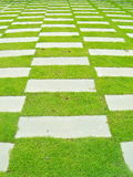 Stone walkway for a seat on the grass Royalty Free Stock Photos