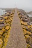Stone Walkway to Lighthouse Royalty Free Stock Photo