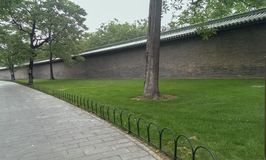 Stone walkway with tree and brick wall in the Green Park stock image