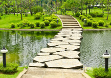 Stone walkway on water Stock Photos