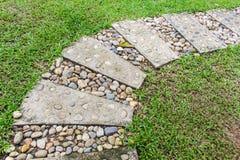 Stone walkway winding in garden Stock Image