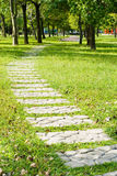 Stone walkway into woods Royalty Free Stock Photos