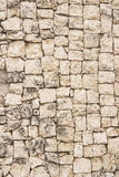 Stone wall 1. Stone wall made of yellowish limestone blocks royalty free stock image