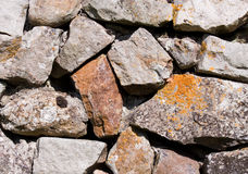 Stone Wall. Close up of a roughstone wall Stock Photo
