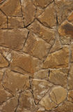 Stone wall. Orange stone wall, selective focus on center royalty free stock photo
