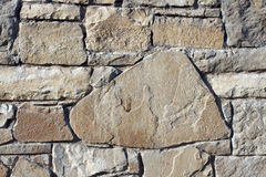 Stone wall. An old solid stone wall Stock Photos