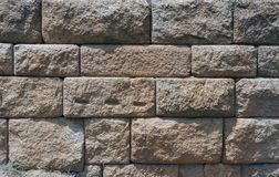 Stone wall. An old solid stone wall Stock Images