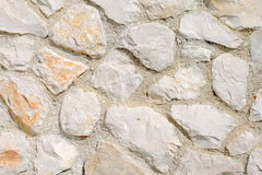 Stone wall. Rough Mediterranean stone wall background Stock Photo