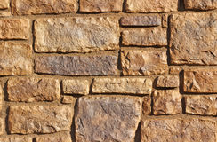 Stone Wall. Brown painted wall of various size stone for background Royalty Free Stock Photo