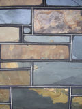 Stone wall. Wall background made from slate colored bricks Stock Photos
