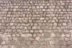 Stone in the wall. Grey stone in the wall Stock Image