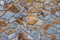 Stone wall. A wall made from stone forming a jigsaw pattern, Thailand Stock Photos