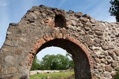 Stone wall. Part of the old castle stone wall with a door stock images