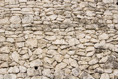 Stone wall 2. Stone wall made of yellowish limestone blocks royalty free stock image