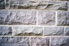 Stone wall. Gray stone wall with stones on top of one another Stock Images