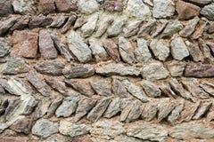 Stone wall. In opus spicatum; herringbone pattern stock photography