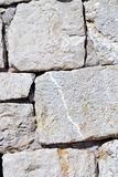 Stone wall. Background of stone wall detail Stock Photos