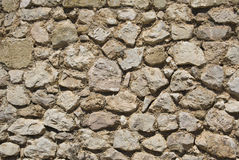 Stone wall. Texture (irregular stones Royalty Free Stock Images