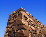 Stone Wall. On blue background Stock Photos