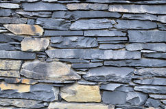 Stone wall. Blue wall of stacked stones and rocks Stock Image