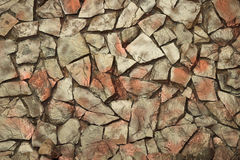 Stone wall. Structure of an old stone wall close up Royalty Free Stock Image