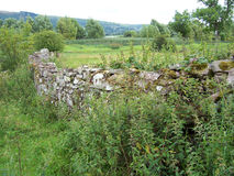 Stone wall. A dry stone wall Stock Images