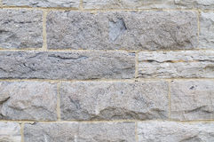 Stone wall. Close-up picture of stone blocks wall (background, texture Royalty Free Stock Image