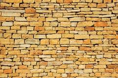 Stone wall. The sandstone processes stone wall sense of reali Stock Photos