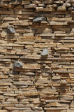 Stone wall. Fragment of a wall from the cut impressive stone Royalty Free Stock Photo