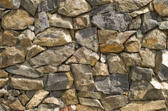 Stone wall. Wall from a natural stone Stock Photos
