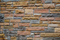 Stone Wall. Closeup of stone block wall with strong contrasting colors stock image