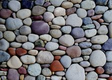 Stone wall. Pebble stone wall Royalty Free Stock Images