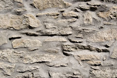 Stone wall. With cement of a rural house Stock Photos