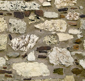 Stone wall. Background. Grunge colors royalty free stock photo
