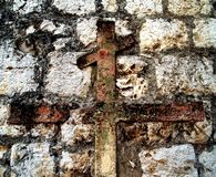 Stone wall. With interesting iron cross Stock Image