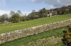 Stone wall above upper houses at Pateley Bridge,North Yorkshire, England, UK. Royalty Free Stock Photography