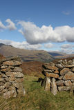 Stone wall access. Traditional dry stone wall provides access to national park land Royalty Free Stock Image