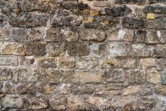 Stone wall aged by time. Background and texture for design royalty free stock image