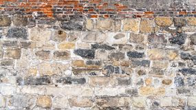 Stone wall aged by time. Background and texture for design stock images