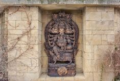 Ganesha sculpture. Stone wall with alcove including a Ganesha sculpture royalty free stock photography