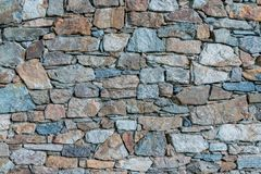 Ancient stone wall built by hand stock photo