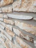 Stone wall at an angle, limestone rock stock photo