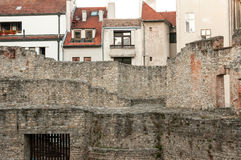 Stone Wall and Apartment Buildings, Sopron, Hungary. Partial stone wall in front of apartment buildings in the Central European city of Sopron, Hungary Royalty Free Stock Photo