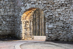 Stone wall with an arch Royalty Free Stock Image