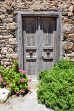 Stone wall with arched wooden door Stock Image