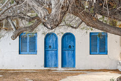 Stone wall with arched wooden doors Stock Photos