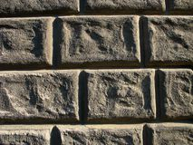 Stone wall background. Detail of a building stone wall Stock Photography