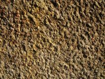Stone wall background. Detail of a building stone wall Royalty Free Stock Photo